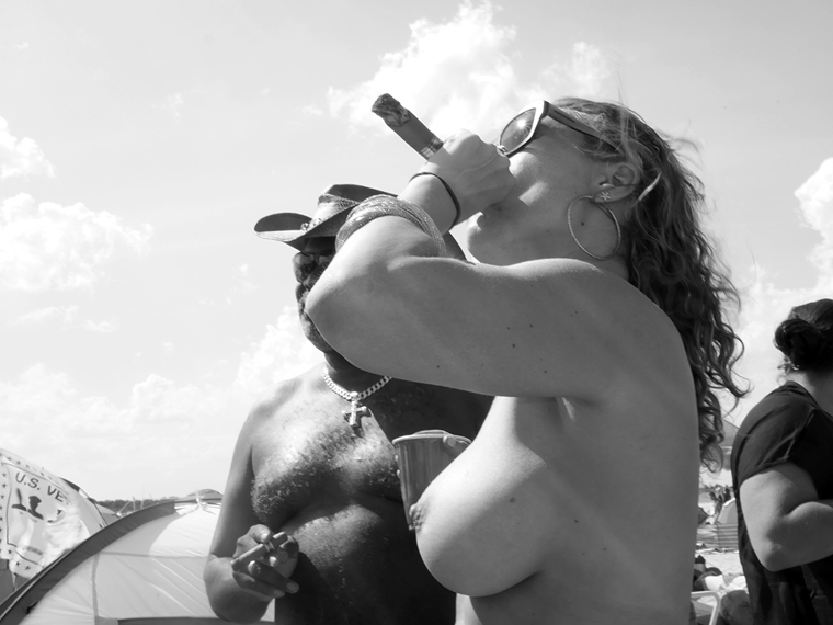 Michael Ast, Mirari, Summer, beach, sand, sun, recreational, naked, nude, ocean, sea, coast, coastal, coastline, naturalists, nudist, nudists, free, freedom, unclothed, bare, heat, vacationing, michaelast, party, cigar, stogie, smoking, blunt, shades, up in smoke, couple, revelry, sunsplash