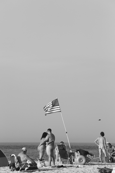 Michael Ast, Mirari, Summer, beach, sand, sun, recreational, naked, nude, ocean, sea, coast, coastal, coastline, naturalists, nudist, nudists, free, freedom, unclothed, bare, heat, vacationing, michaelast, flag, America, American flag, intimacy, hug
