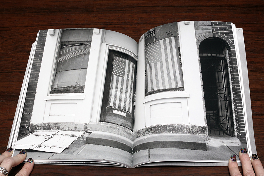 Michael Ast, Trying to Find the Ocean, photobook, Mark Alice Durant, Baltimore, ocean, ominous, black and white photography, michaelast, self-publish, flag, America, United States, American flag, stars stripes, sidewalk, store front, storefront